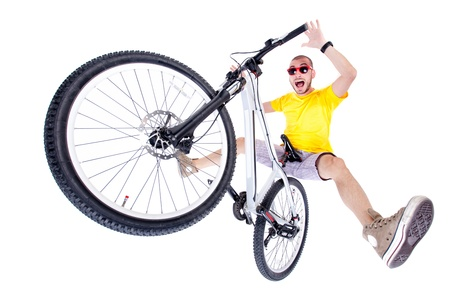 crazy boy on a dirt jump bike isolated on white - wide studio shot