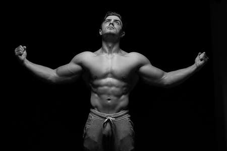 Photo for Sexy muscular fitness man. Black and white image. - Royalty Free Image