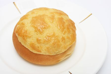 Pineapple bun (Hong Kong pastry) on white plate.