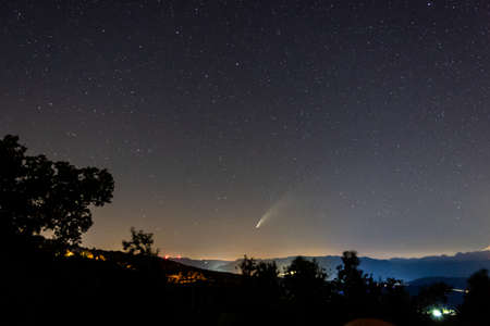 Photo pour Neowise Comet and its long dust tail from Etna Volcano - image libre de droit
