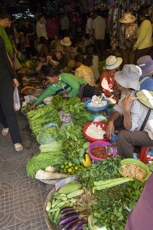 Siem Reap, Cambodia - May 3, 2013: A busy scene of shoppers and market vendors in Siem Reap Market in Cambodia