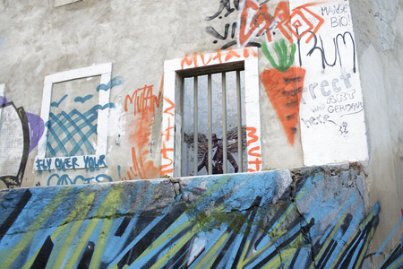 Lisbon, Portugal - February 16, 2014: Calcada do Lavra street in Lisbon with its graffiti and nobody around