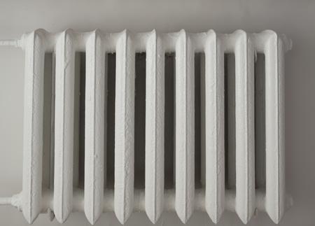 White radiator in the dark stairwell