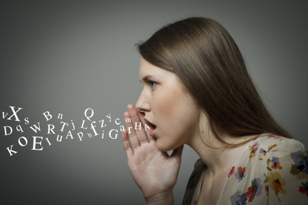 Photo for Young woman whispering something - Royalty Free Image
