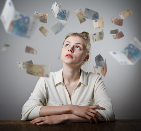 Girl in white and falling Euro banknotes. Currency and lottery concept. Young slim woman.