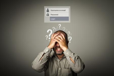 Photo pour Frustrated man. Forgot password concept. Man suffering from headache. Question-marks. - image libre de droit