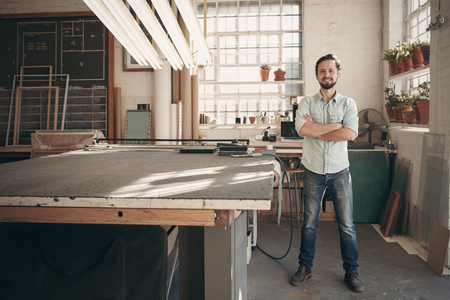 Photo pour Full length portrait of a young male designer confidently standing with his arms crossed in his workshop and smiling at the camera - image libre de droit