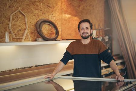 Photo pour Craftsman standing positively in his design studio looking proud and confident - image libre de droit