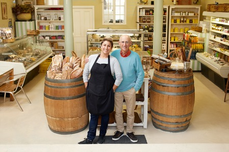 Foto per A father and daugther standing together in their deli - Immagine Royalty Free