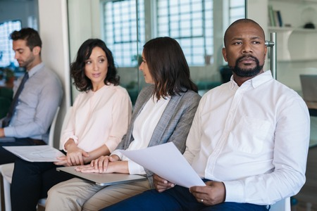 Photo for Man preparing for his interview while waiting with other applicants - Royalty Free Image