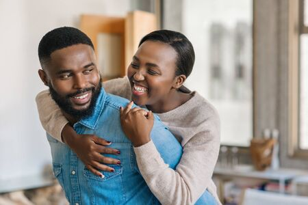 Photo pour Playful young African American couple relaxing together at home - image libre de droit