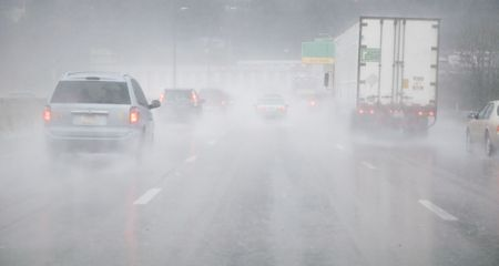 Vehicles on wet road in the rain