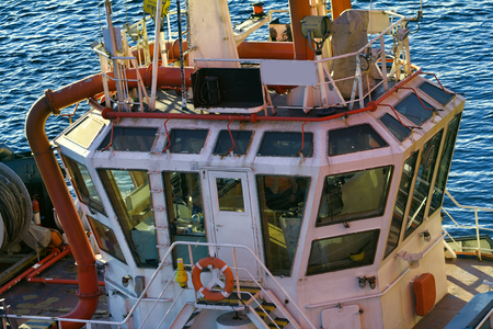 Wheelhouse marine tug all-round visibility, vessel towing, tow-out . Port Of Murmansk