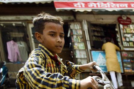 India, Mahora-March 22, 2018: boy on a bike, dynamic photo