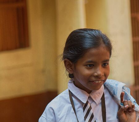 India, Varanasi - March 20, 2018: portraits of Indian children, younger schoolgirl