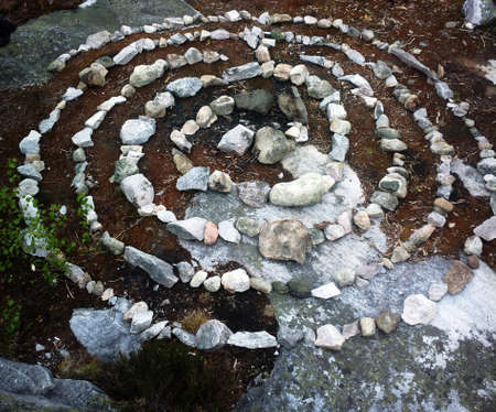 Photo for A spiral labyrinth made of stones. This is about how sacred labyrinths of primitive hunters looked, prehistoric magic art - Royalty Free Image