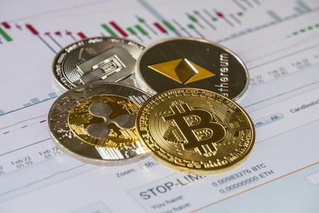 Cryptocurrency coins over buy and sell trading graphic; Bitcoin, Ethereum, Dash and Ripple coins
