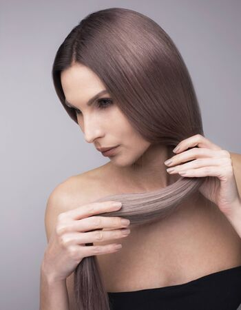 Photo pour Vertical studio shot of a woman with healthy, strong, long purple hair. - image libre de droit