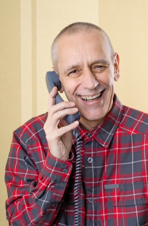 Happy man laughing and speaking with a friend on phone