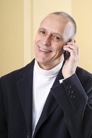 Happy businessman having good news on mobile phone