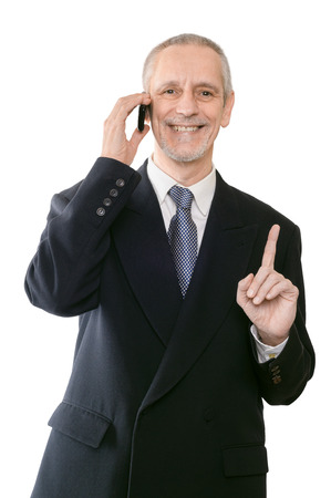 An handsome businessman smiling on mobile phone and showing the forefinger