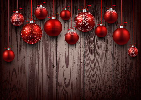 Christmas wooden background with red balls.