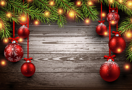 Christmas wooden background with fir branches and balls.
