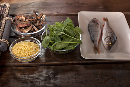 fish on textured wooden background. Culinary healthy cooking.