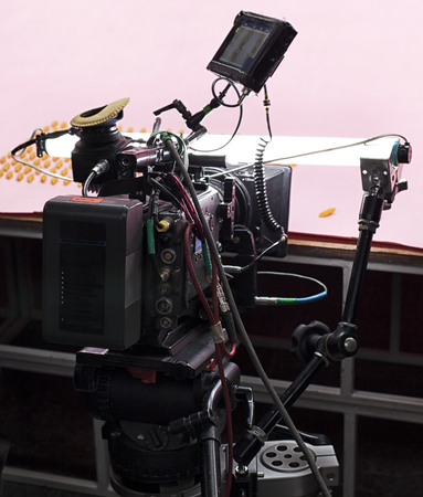 A professional video camera, cinematography in the pavilion.