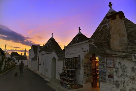 Foto per Walking between the Trulli - Alberobello BA - Immagine Royalty Free