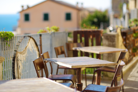 Photo for Beautifully decorated small outdoor restaurant tables in Riomaggiore village, Cinque Terre, Liguria, Italy - Royalty Free Image