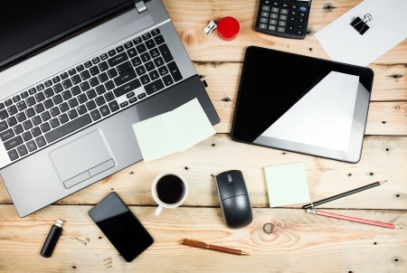 Workplace, laptop and tablet pc on wooden table