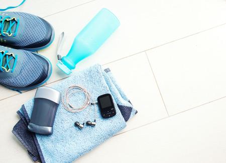 Photo pour Pair of sport shoes and fitness accessories. Fitness concept - image libre de droit