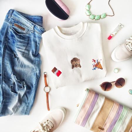female fashion stuff on white background, top view