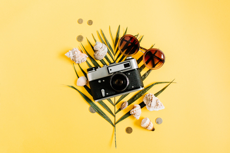 Flat lay traveler accessories on yellow background. Top view travel or vacation concept. Summer background.