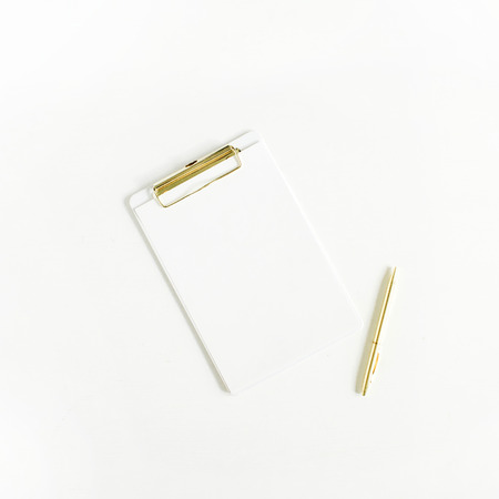 Clipboard with paper blank and pen on white background. Flat lay, top view.