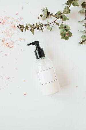 Photo pour Healthcare spa concept with copy space liquid soap bottle on white background. Flat lay, top view beauty lifestyle composition. - image libre de droit