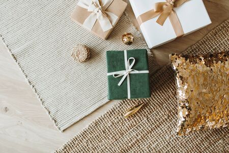 Photo pour Christmas / New Year gift boxes with bows. Winter holidays gifts packaging concept. Flat lay, top view. - image libre de droit