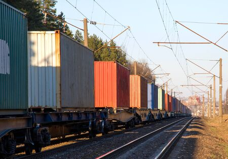 Photo for Cargo containers transportation on freight train by railway. Coronavirus Wreaks Havoc On Global Industry. Global economy is heading into a recession thanks to the widening fallout from the COVID-19 - Royalty Free Image
