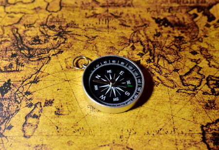 Photo pour Compass on map. Tourist compass for orientation on the terrain. Magnetic declination сalculator. Historical explorer help. Map reading and land navigation concept. Orient on maps - image libre de droit