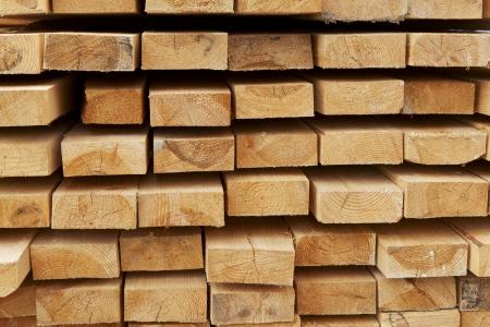 Photo pour stack of pine boards on building materials warehouse - image libre de droit