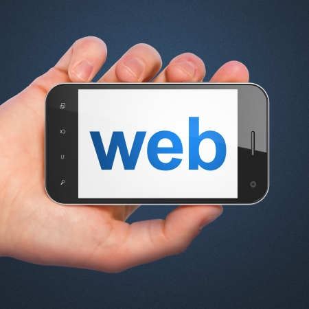 Photo pour SEO web development concept  hand holding smartphone with word Web on display  Generic mobile smart phone in hand on Dark Blue background  - image libre de droit
