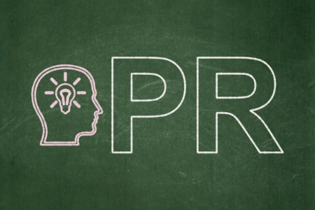 Advertising concept: Head With Lightbulb icon and text PR on Green chalkboard background, 3d render
