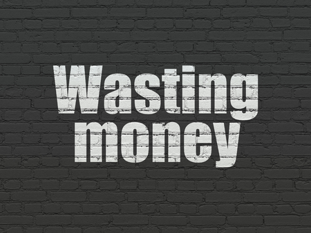 Banking concept: Painted white text Wasting Money on Black Brick wall background