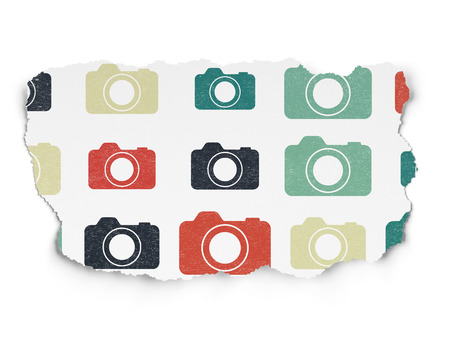 Tourism concept: Painted multicolor Photo Camera icons on Torn Paper background