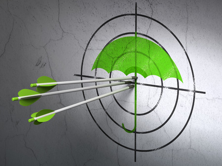 Success security concept: arrows hitting the center of Green Umbrella target on wall background