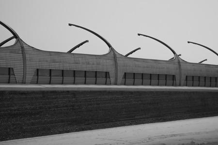 Architecture lines under the bridge. Speedway black and white