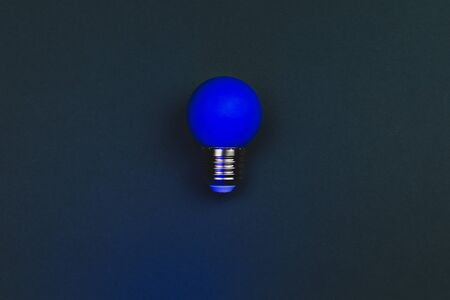 Photo for Blue light bulb on the dark background. single bulb with copy space - Royalty Free Image