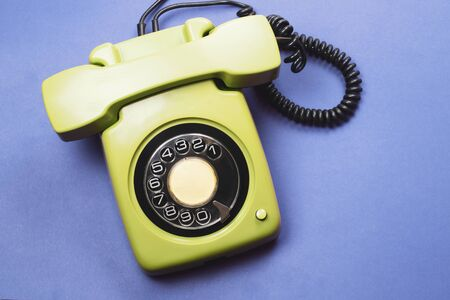 Photo pour Classic phone with handset. vintage green telephone with phone receiver isolated on color background. old communication technology. copy space - image libre de droit