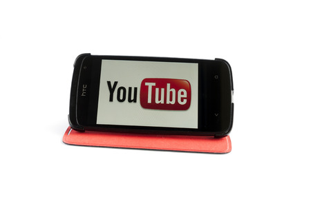 Bucharest, Romania - Jan 24, 2014: Photo of YouTube on smartphone screen. YouTube is a video-sharing website, created by three former PayPal employees in February 2005 and owned by Google since late 2006, on which users can upload, view and share videos,